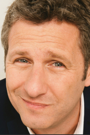 Bookcomedian Adam Hills for your next event